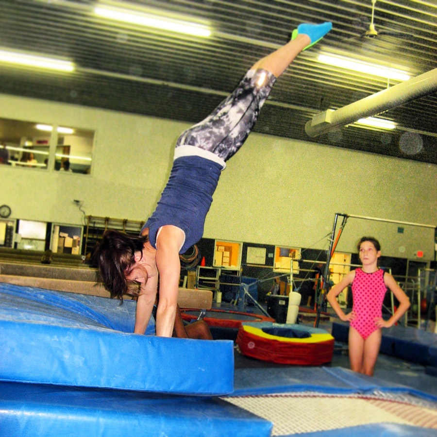 A child does a handstand.